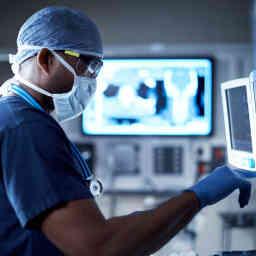 Vigilantly monitoring his patient's vitals